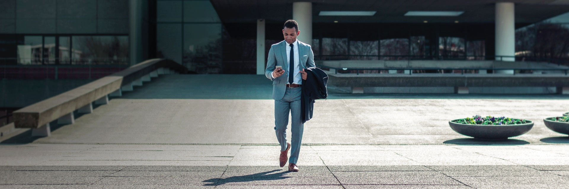 Attorney-walking-out-of-office-on-smartphone